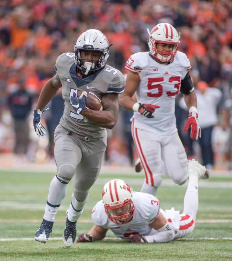 Illinois running back Ke'Shawn Vaughn makes a long run culminating in a touchdown against Wisconsin during the Homecoming game at Memorial Stadium on Saturday, October 24. Illinois lost 13-24.