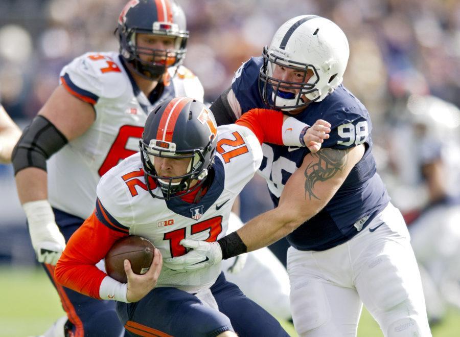 Penn+State+defensive+tackle+Anthony+Zettel%2C+right%2C+sacks+Illinois+quarterback+Wes+Lunt+on+Saturday+at+Beaver+Stadium+in+University+Park%2C+Pennsylvania.%26nbsp%3BAbby+Drey%2C+Tribune+News+Service