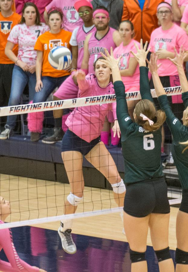 Michelle Strizak spikes the ball during the game against Michigan State at Huff Hall on Friday, Oct. 30. Illinois won 3-1.