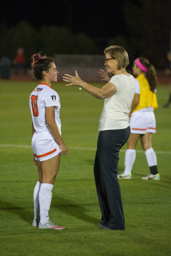 Coach Janet Rayfield talks with Allison Stucky during the game against Rutgers at Illinois Soccer and Track Stadium on Thursday, Sept. 24. Illinois won 2-1.