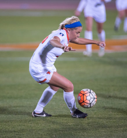 Katie Murray tries to dribble around a defender during the game against Iowa at Illinois Soccer and Track Stadium on Thursday, October 15. Illinois lost 0-1.
