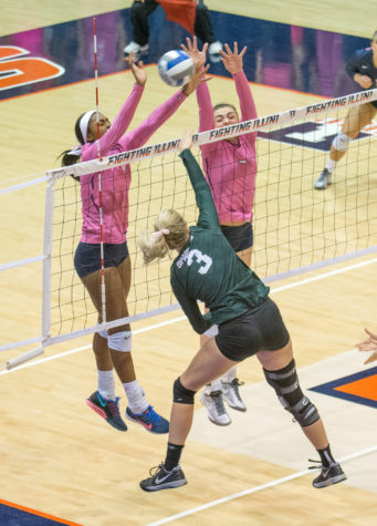 (left) Naya Crittenden and (right) Ali Bastianelli jump to block and attack during the game against Michigan State at Huff Hall on Friday, Oct. 30. Illinois won 3-1.