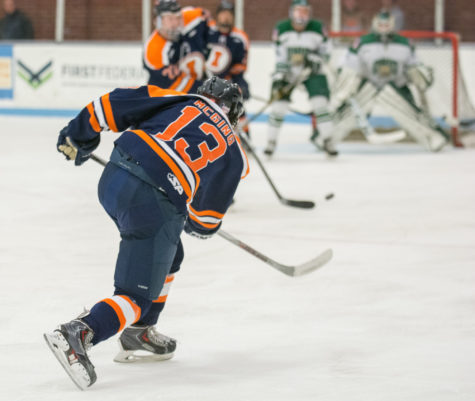 James Mcging shoots the puck during the game against Ohio University at the Ice Arena on Saturday, Oct. 24. Illinois lost 2-3 in a shootout.