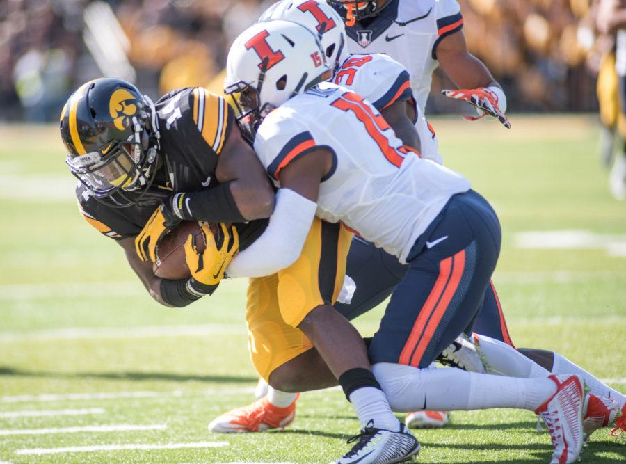 Iowa defensive back Desmond King gets tackled during a punt return in the game against Illinois at Kinnick Stadium on Saturday, Oct. 10.