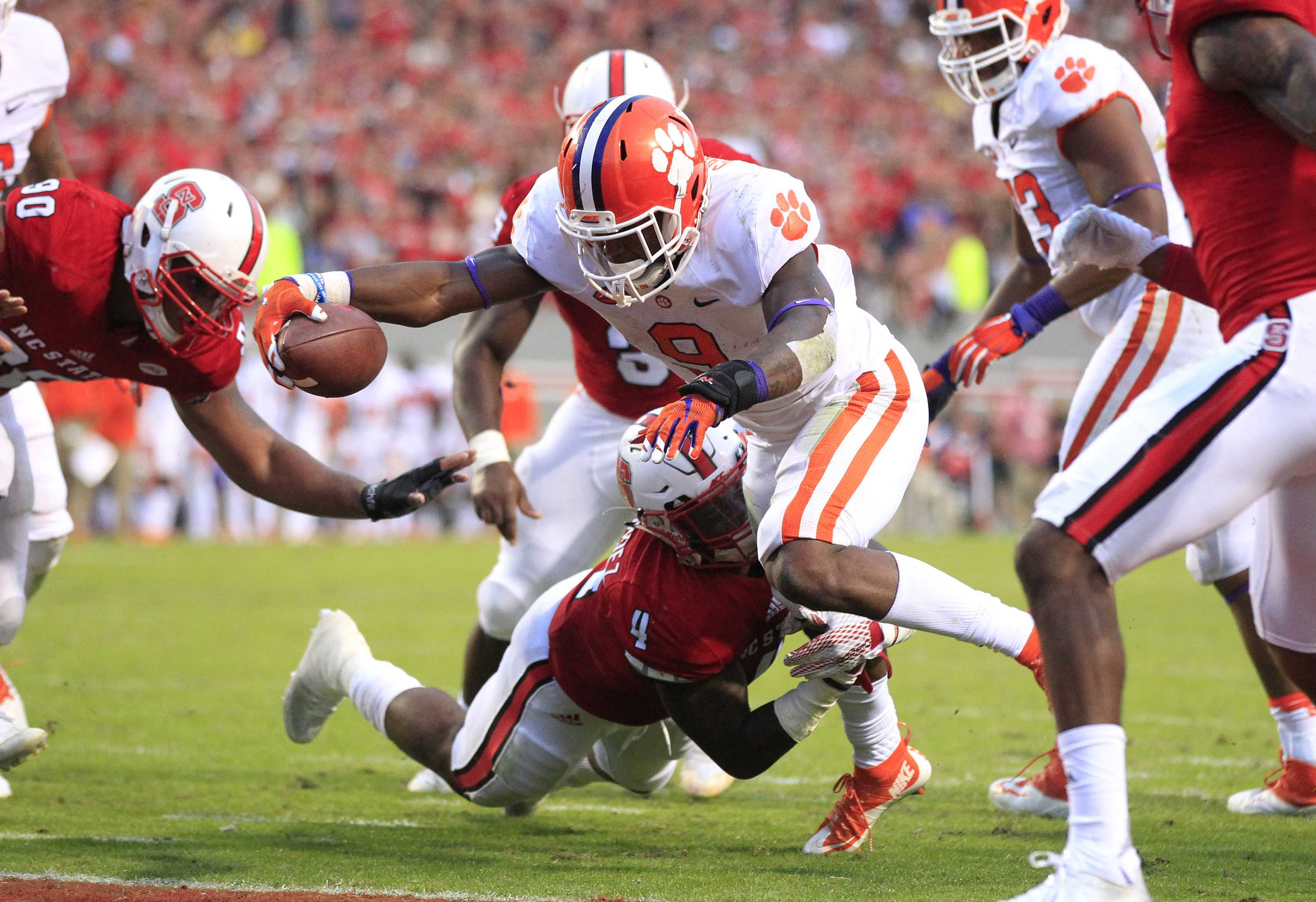 Clemson running back Wayne Gallman (9) scores on a 3-yard touchdown run during the second half against North Carolina State at Carter-Finley Stadium in Raleigh, N.C., on Saturday, Oct. 31, 2015. Clemson won, 56-41. (Ethan Hyman/Raleigh News & Observer/TNS)
