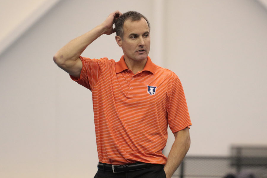 Illinois' head coach Brad Dancer observes a match during the tennis game v. Northwestern at Atkins Tennis Center on Friday, Feb. 20, 2015. Illinois won 5-2.