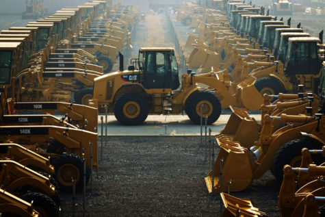A Cat980 wheel loader runs among finished products in open air in Caterpillar Co., Ltd. in Suzhou, east China's Jiangsu Province, Dec. 14, 2011. (Liu Bin/Zuma Press/TNS)