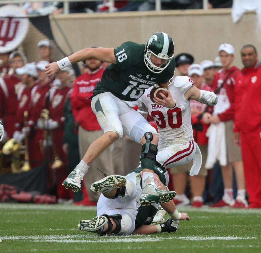 Michigan State quarterback Connor Cook runs for a first down against Indiana during the first half on Saturday, Oct. 24, 2015, at Spartan Stadium in East Lansing, Mich. (Kirthmon F. Dozier/Detroit Free Press/TNS)
