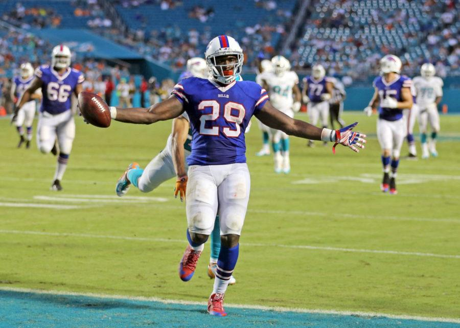 The Miami Dolphins defense fails to stop Buffalo Bills' Karlos Williams as he scores a touchdown during the fourth quarter on Sunday, Sept. 27, 2015, at Sun Life Stadium in Miami Gardens, Fla. (Charles Trainor Jr./Miami Herald/TNS)