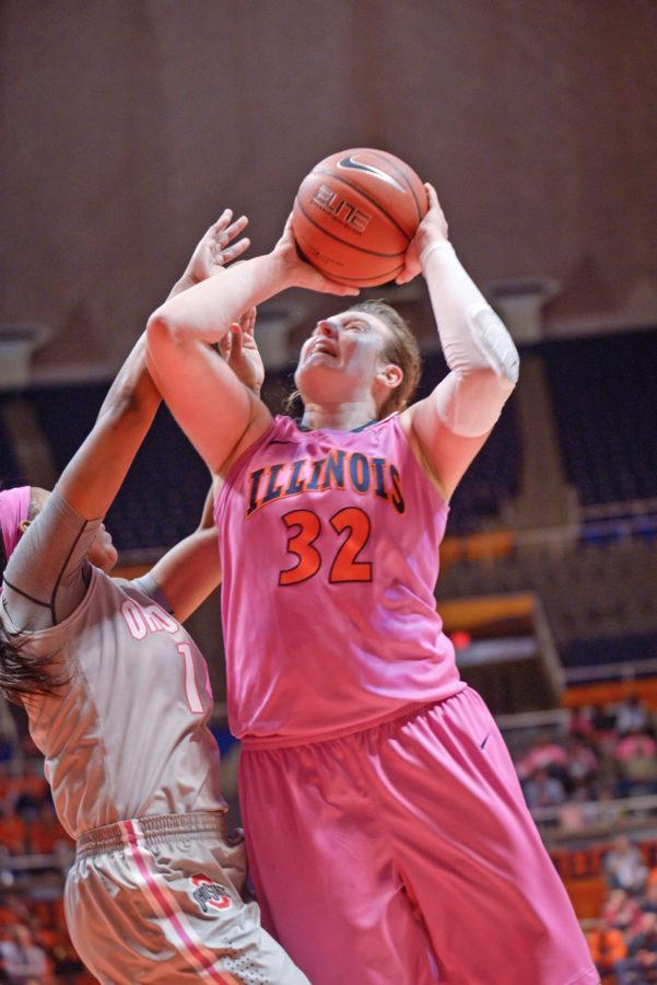 Illinois' Chatrice White attacks the rim during the game against Ohio State at the State Farm Center on Saturday, February 14, 2015. The Illini won 66-55.
