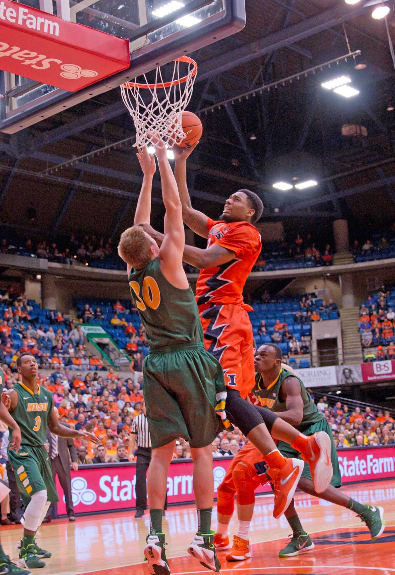 Mike Thorne Jr. takes the ball to the rim during the game against North Dakota State on Sunday at the Prairie Capitol Convention Center.