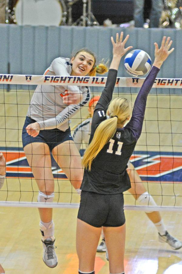 Illinois' Ali Bastianelli (5) attempts to spike the ball during the match against Northwestern at Huff Hall on Saturday, Nov. 7, 2015. Illinois won 3-1.