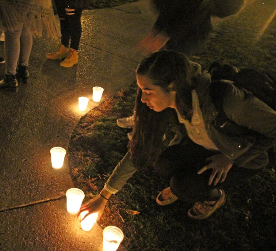 Students light candles during a vigil in support of those affected by the recent tragedies in Paris.