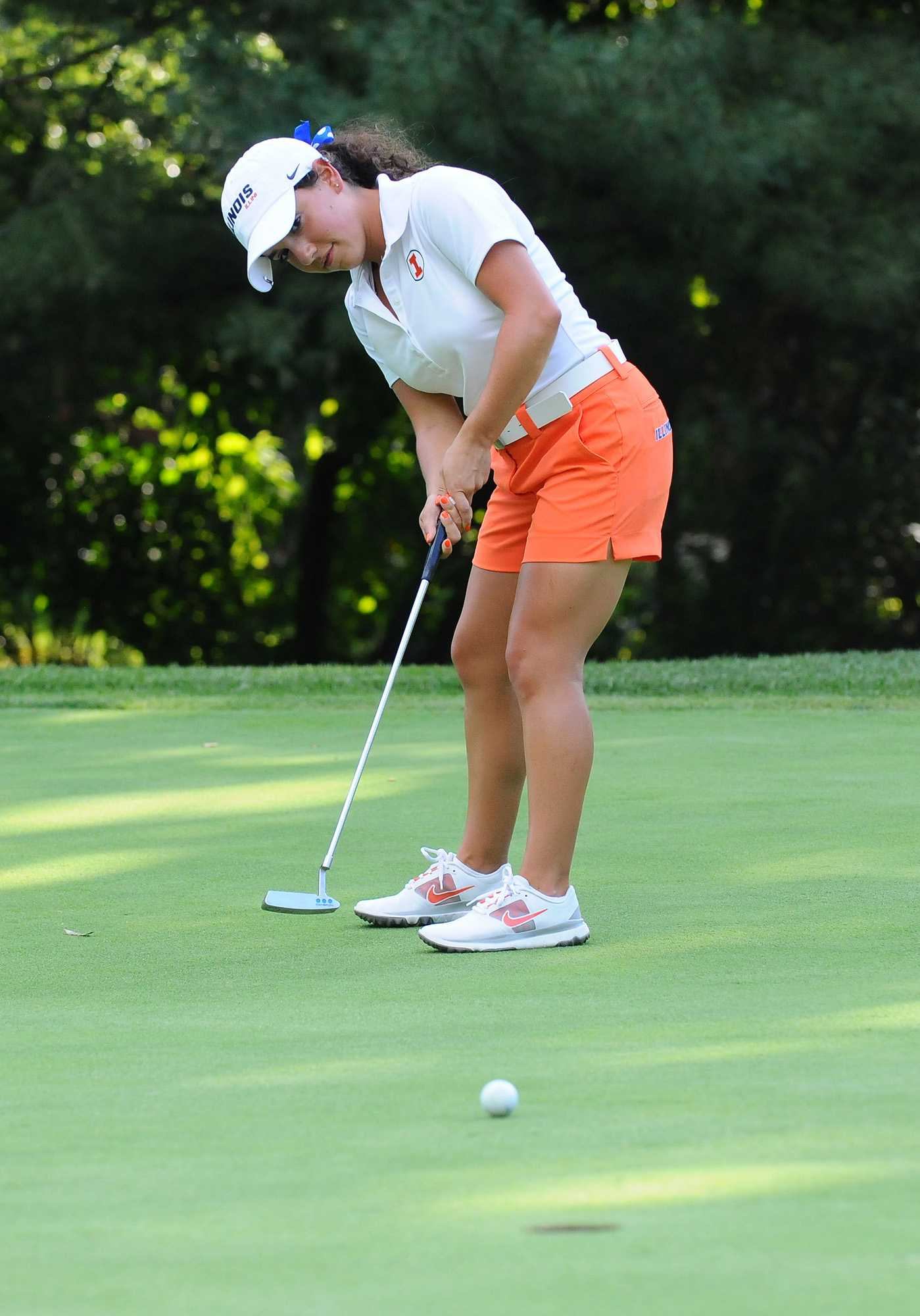 Illini women's golfer Dana Gattone tracks a putt. Gattone stands at 4 foot 10 inches and came to Illinois from Saint Viator High School.