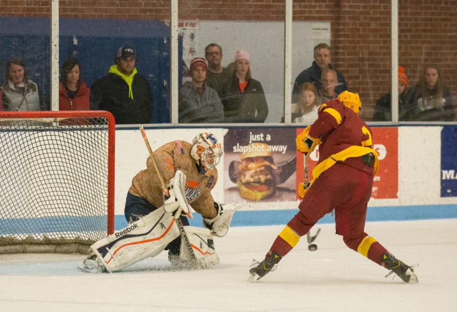 Joe Olen tracks the puck and makes a save in the shootout  against Iowa State on Saturday. Illinois lost 3-2.