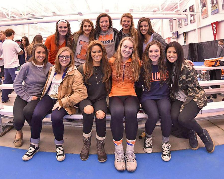 Members of the Illini soccer team at an Illinois women's tennis match at Atkins Tennis Center