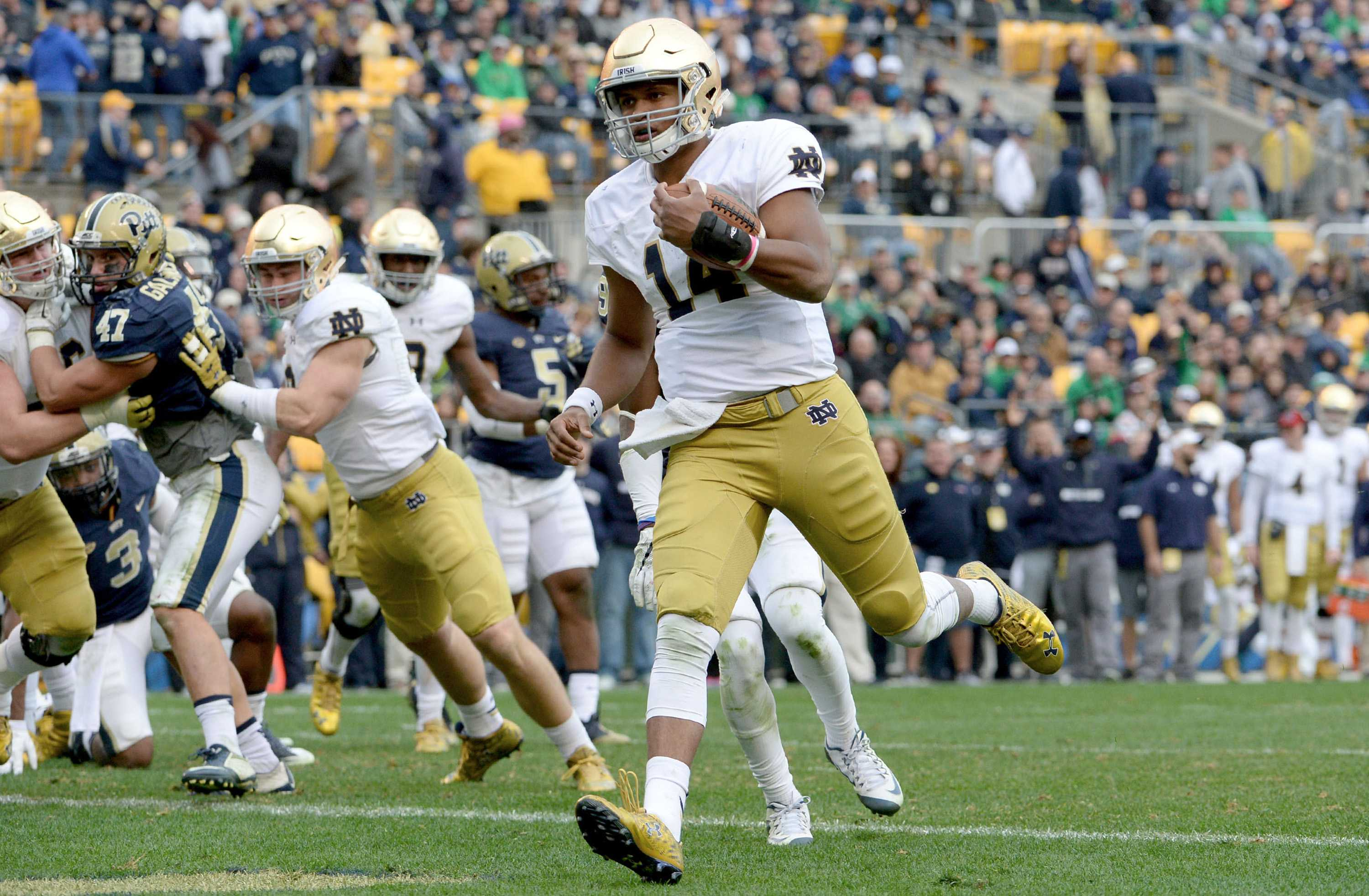 Notre Dame quarterback DeShone Kizer scores a touchdown on a 2-yard against Pitt in the fourth quarter at Heinz Field in Pittsburgh, on Saturday, Nov. 7, 2015. Notre Dame won, 42-30. (Matt Freed/Pittsburgh Post-Gazette/TNS)