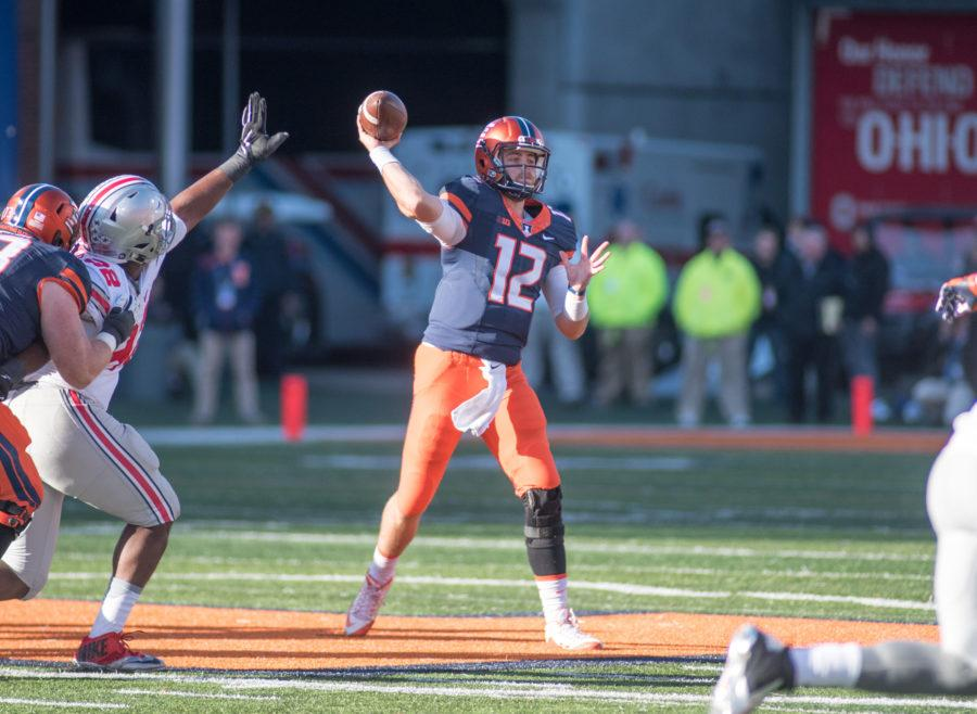 Quarterback Wes Lunt throws a pass during Saturday's game against Ohio State at Memorial Stadium. Illinois lost 28-3.