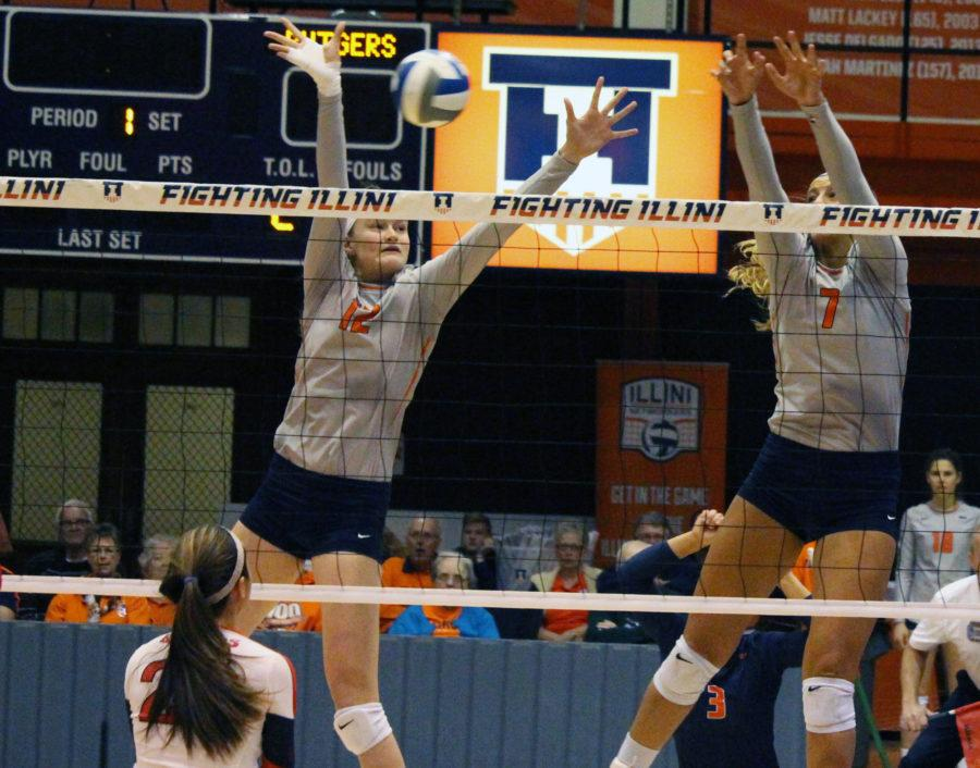 Illinois' Katie Stadick (12) and Jocelynn Birks (7) attempt a block during the game against Rutgers at Huff Hall, on Saturday, Nov. 14th. The Illini won 3-0.