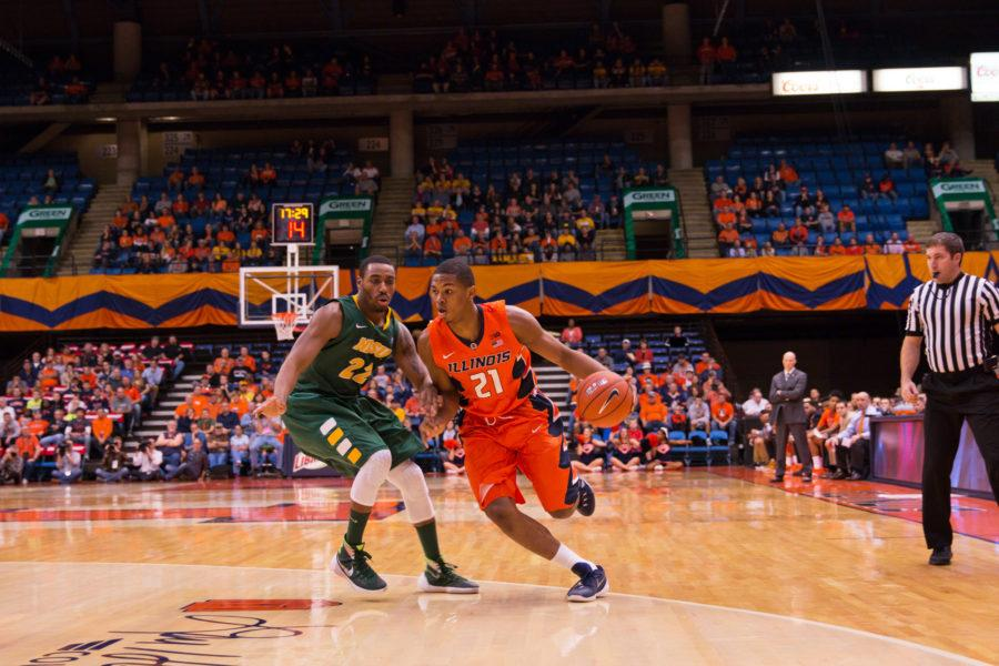 Illinois' Malcolm Hill (21) dribbles around his defender during the game against North Dakota State at the Prairie Capital Convention Center in Springfield, Illinois, on Sunday, November 15, 2015. The Illini won 80-74.