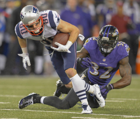 New England Patriots wide receiver Danny Amendola breaks free from Baltimore Ravens strong safety James Ihedigbo following a reception during the first half of their game in Baltimore on Sunday, Dec. 22, 2013. (Doug Kapustin/MCT)