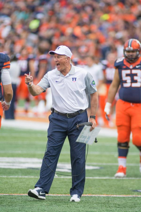 Coach Bill Cubit shares stern words during the game against Middle Tennessee State at Memorial Stadium on Saturday, Sept. 26. Illinois won 27-25.