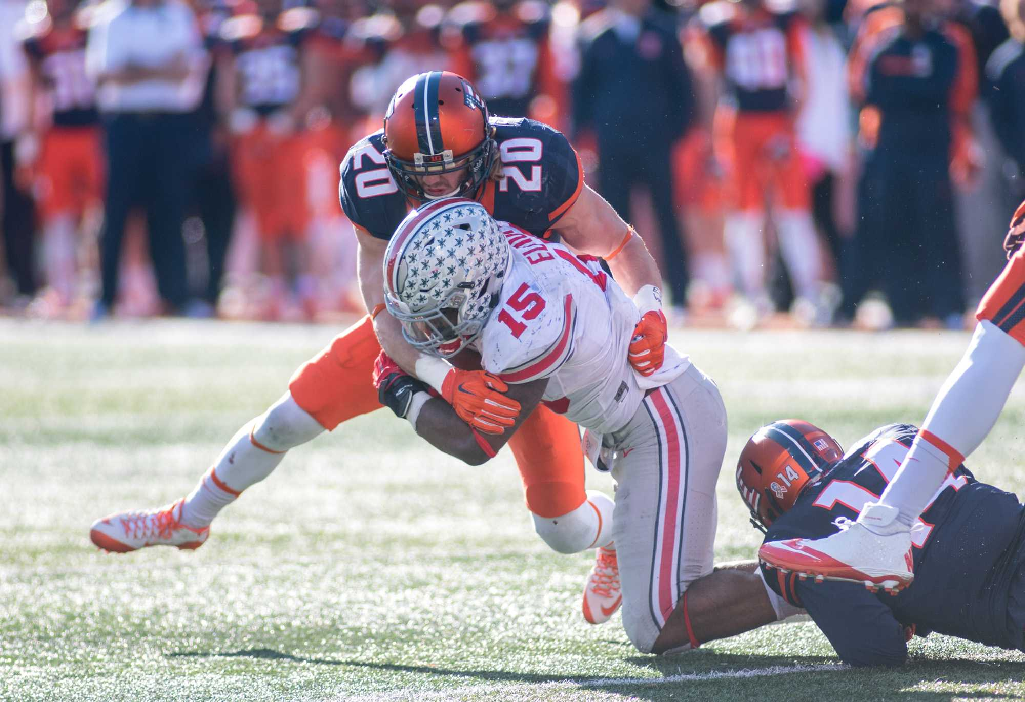 Defensive back Clayton Fedejelem makes a tackle on Ohio State running back Ezekiel Elliot during Saturday's game at Memorial Stadium. Illinois lost 28-3.