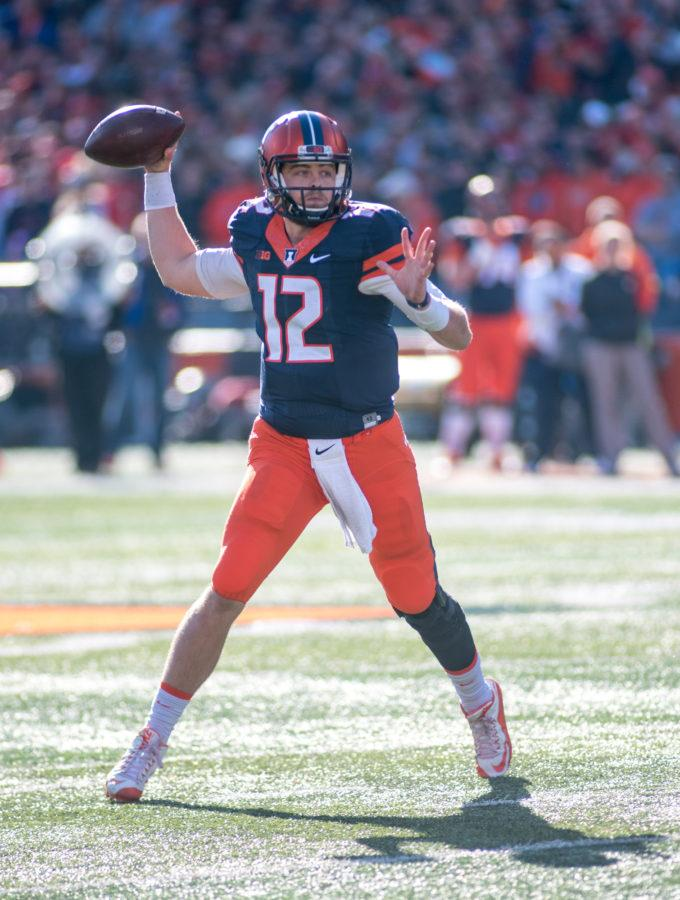Quarterback Wes Lunt winds up to throw a pass during the game against Ohio State at Memorial Stadium on Saturday. Illinois lost 28-3.
