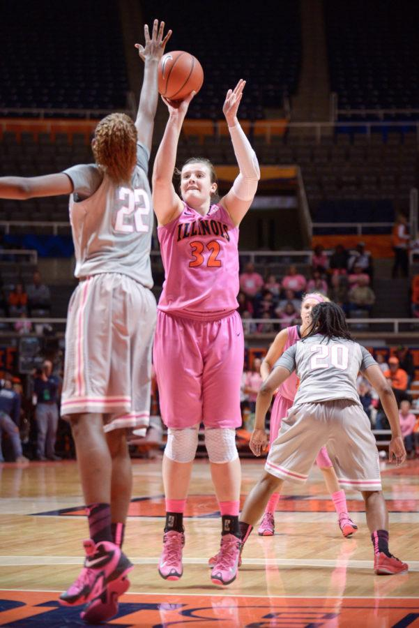 Illinois' Chatrice White attempts a contested shot during the game against Ohio State at the State Farm Center on Saturday, February 14, 2015. The Illini won 66-55.