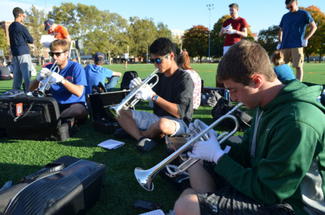 The trumpet section gets warmed up before practice.