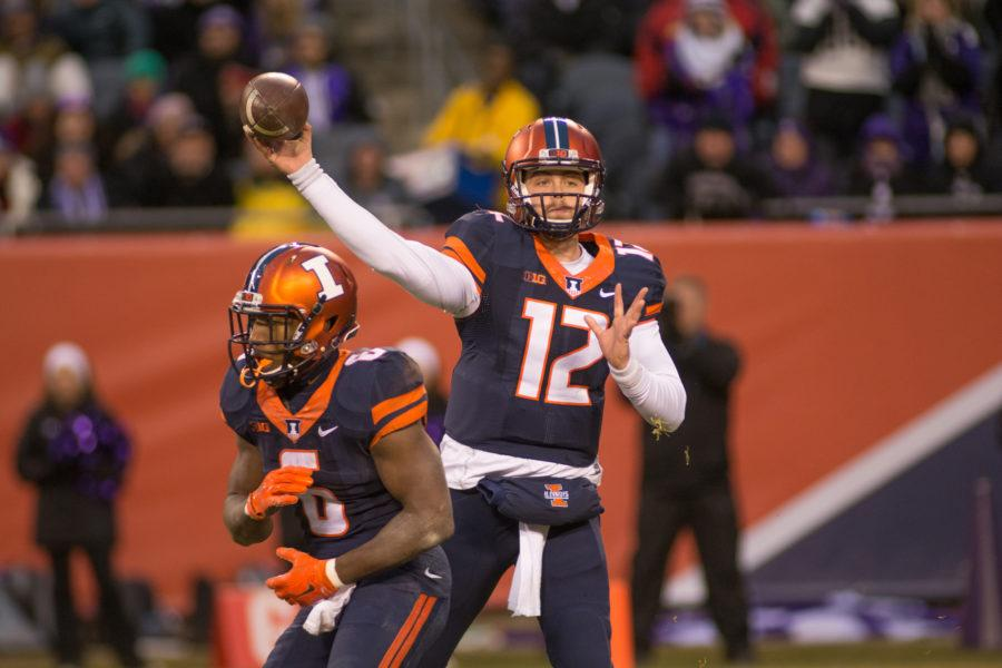 Quarterback Wes Lunt makes a throw during the game against Northwestern at Soldier Field on Saturday. Illinois lost 24-14.