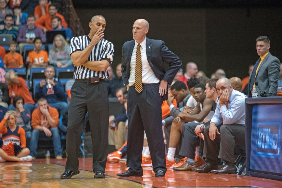 Head+coach+John+Groce+speaks+with+a+referee+during+the+game+against+North+Florida+at+the+Prairie+Capitol+Convention+Center+on+Friday%2C+Nov.+13.+Illinois+lost+93-81.