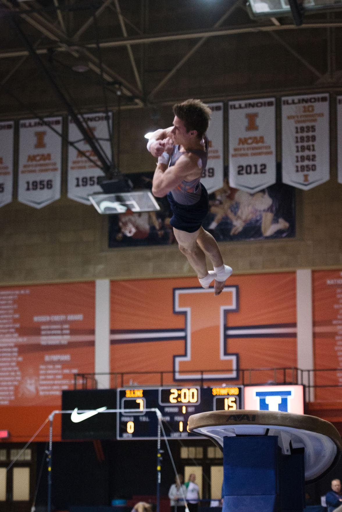 Illinois' Bobby Baker launches off the vault during the meet against Stanford at Huff Hall on Friday, March 6. The Illini lost 21-9.