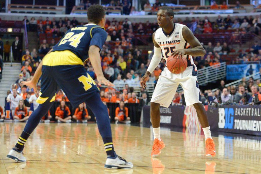 Illinois' Kendrick Nunn (25) is guarded by Michigan's Aubrey Dawkins (24) during the game at United Center in Chicago, Illinois during the Big Ten Tournament on Thursday, March 12, 2015. The Illini lost 73-55.