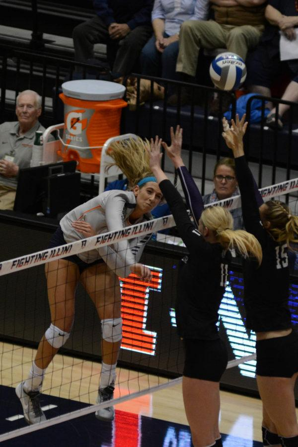 Illinois' Jocelynn Birks (7) attempts to spike the ball during the match against Northwestern at Huff Hall on Saturday, Nov. 7, 2015. Illinois won 3-1.