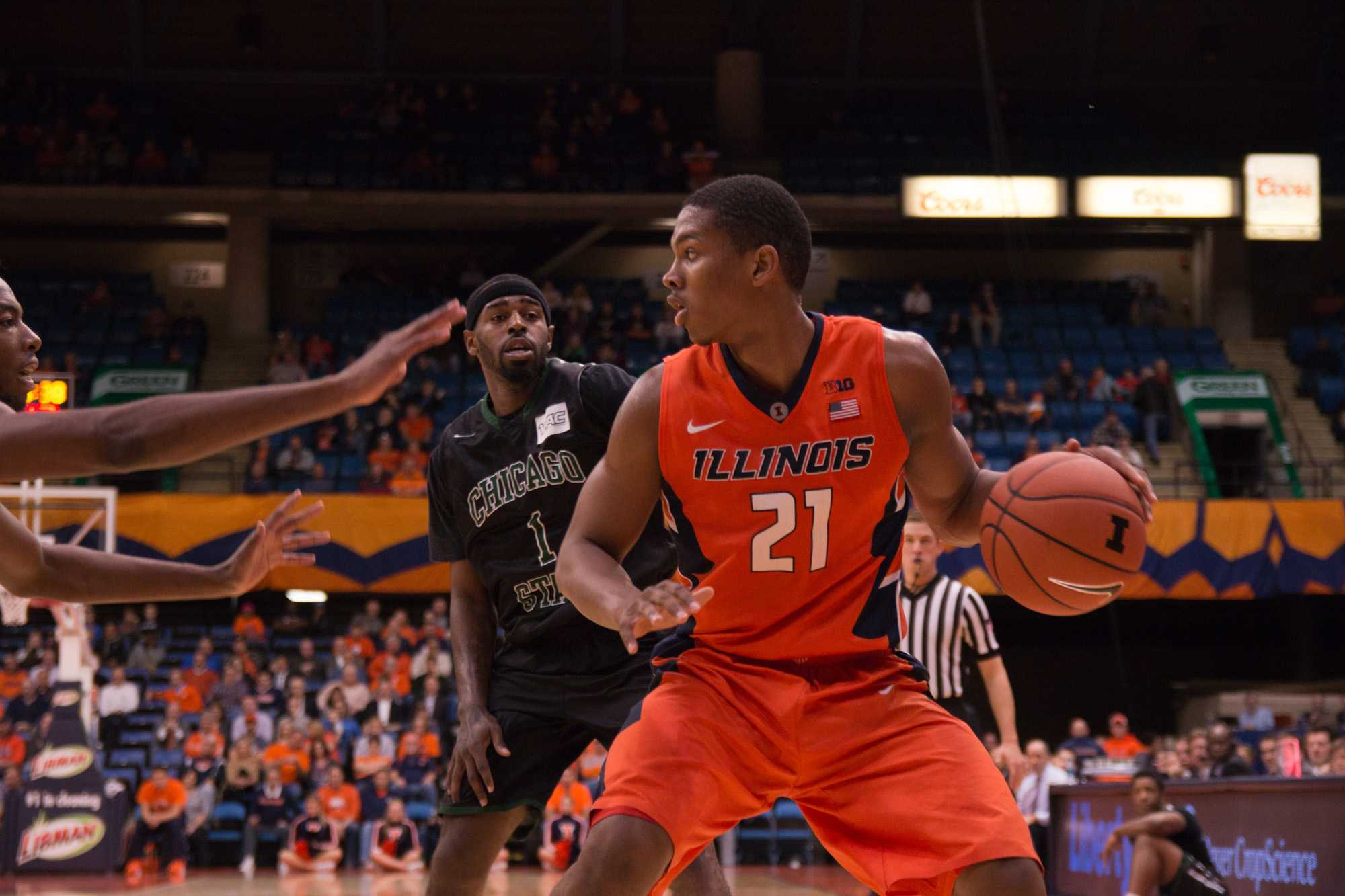 Illinois' Malcolm Hill(21) looks to pass the ball during the game against Chicago State at the Prairie Capital Convention Center in Springfield, Illinois, on Monday, November 23, 2015. The Illini won 82-79.