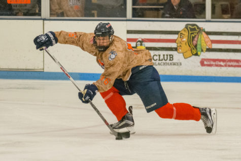 John Olen sends a pass across the ice during the game against Iowa State at the Ice Arena on Saturday, Nov. 14. Illinois lost 3-2 in a shootout.