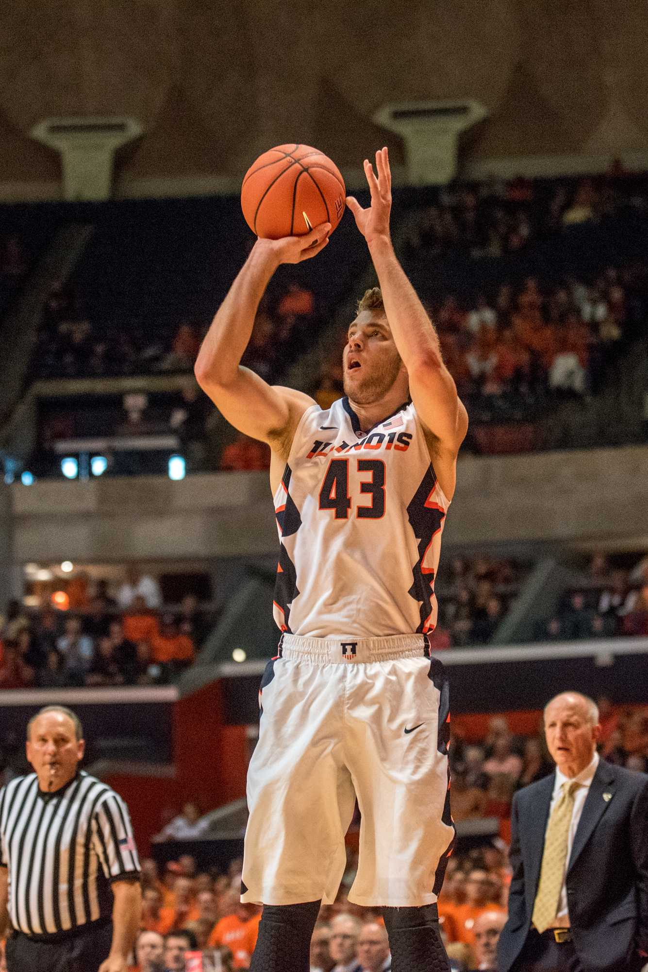 Forward Michael Finke takes a three point shot during the game against Western Carolina at State Farm Center on Saturday.