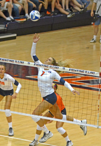 Illinois' Jocelynn Birks (7) attempts to dink the ball during the game versus Louisville at Huff Hall on Friday, August 28, 2015.The Illini won 3-0.