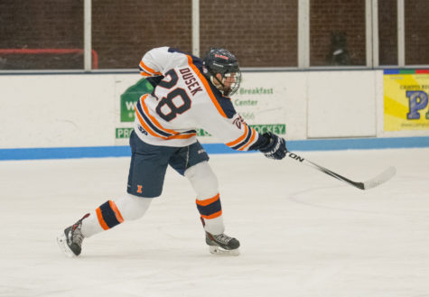 Aaron Dusek takes a shot during the game against Indiana at the Ice Arena on Saturday, Nov. 6. Illinois won 5-2.