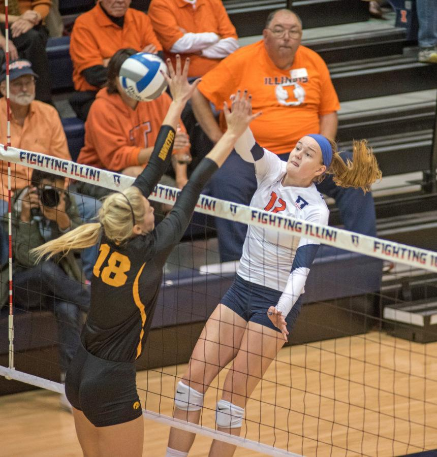 Katie+Stadick+spikes+the+ball+during+the+game+against+Iowa+at+Huff+Hall+on+Friday%2C+Oct.+16.+Illinois+won+3-0.