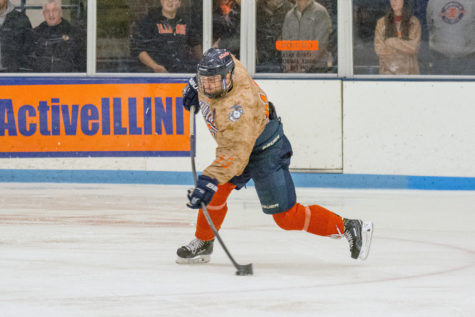 Eric Cruickshank takes a shot during the game against Iowa State at the Ice Arena on Saturday, Nov. 14. Illinois lost 3-2 in a shootout.