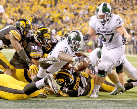Michigan State running back LJ Scott (3) dives in for a touchdown during the fourth quarter against Iowa in the Big Ten Championship at Lucas Oil Stadium in Indianapolis on Saturday, Dec. 5, 2015. The Spartans won, 16-13. (Kirthmon F. Dozier/Detroit Free Press/TNS)