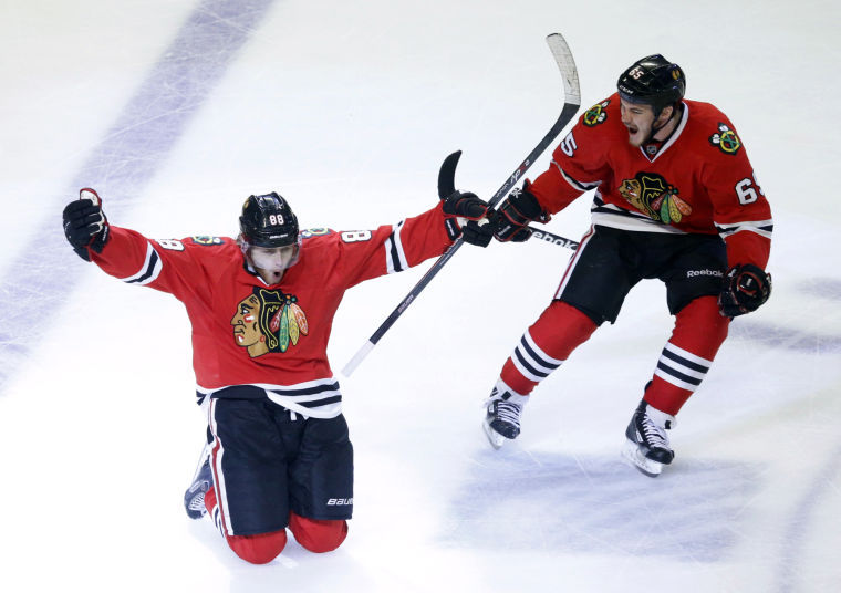 Chicago+Blackhawks+right+wing+Patrick+Kane+%2888%29+celebrates+his+goal+with+center+Andrew+Shaw+%2865%29+during+the+second+overtime+period+in+Game+5+of+the+NHL+hockey+Stanley+Cup+playoffs+Western+Conference+finals+against+the+Los+Angeles+Kings%2C+Saturday%2C+June+8%2C+2013%2C+in+Chicago.+The+Blackhawks+won+4-3+and+advanced+to+the+Stanley+Cup+finals.%0A