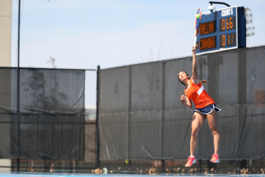 Illinois' Louise Kwong serves the ball during the match against Rutgers at Atkins Tennis Center, on April 5.