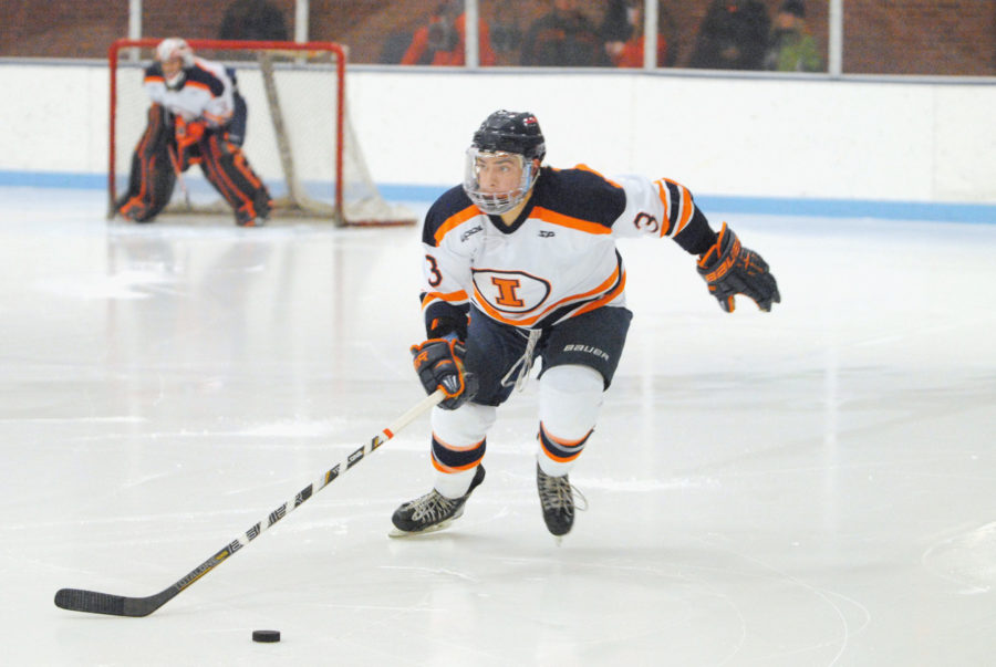 Michael Bojda The Daily IlliniAustin Zima skates with the puck during the 2nd period in a 6-3 win against Indiana Saturday night at the Ice Arena.