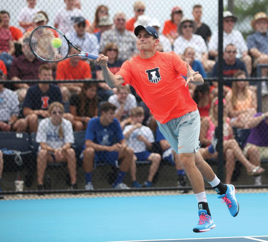 Illinois' Jared Hiltzik swings for the ball during the second round of NCAA Men's Tennis Regionals v. Drake at Khan Outdoor Tennis Complex on Saturday, May 9, 2015. Illinois won 4-2.