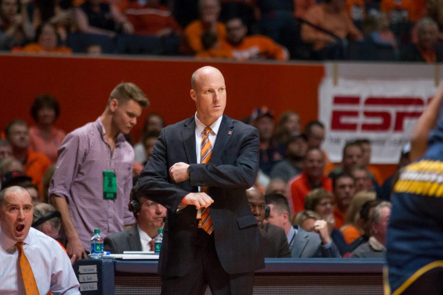 John+Groce+patrolling+the+sideline+during+Illinois%27+78-68+loss+to+Michigan+at+State+Farm+Center+on+Wednesday.+Groce%27s+team+fell+to+0-2+in+Big+Ten+play+after+losing+to+Ohio+State+on+Sunday.