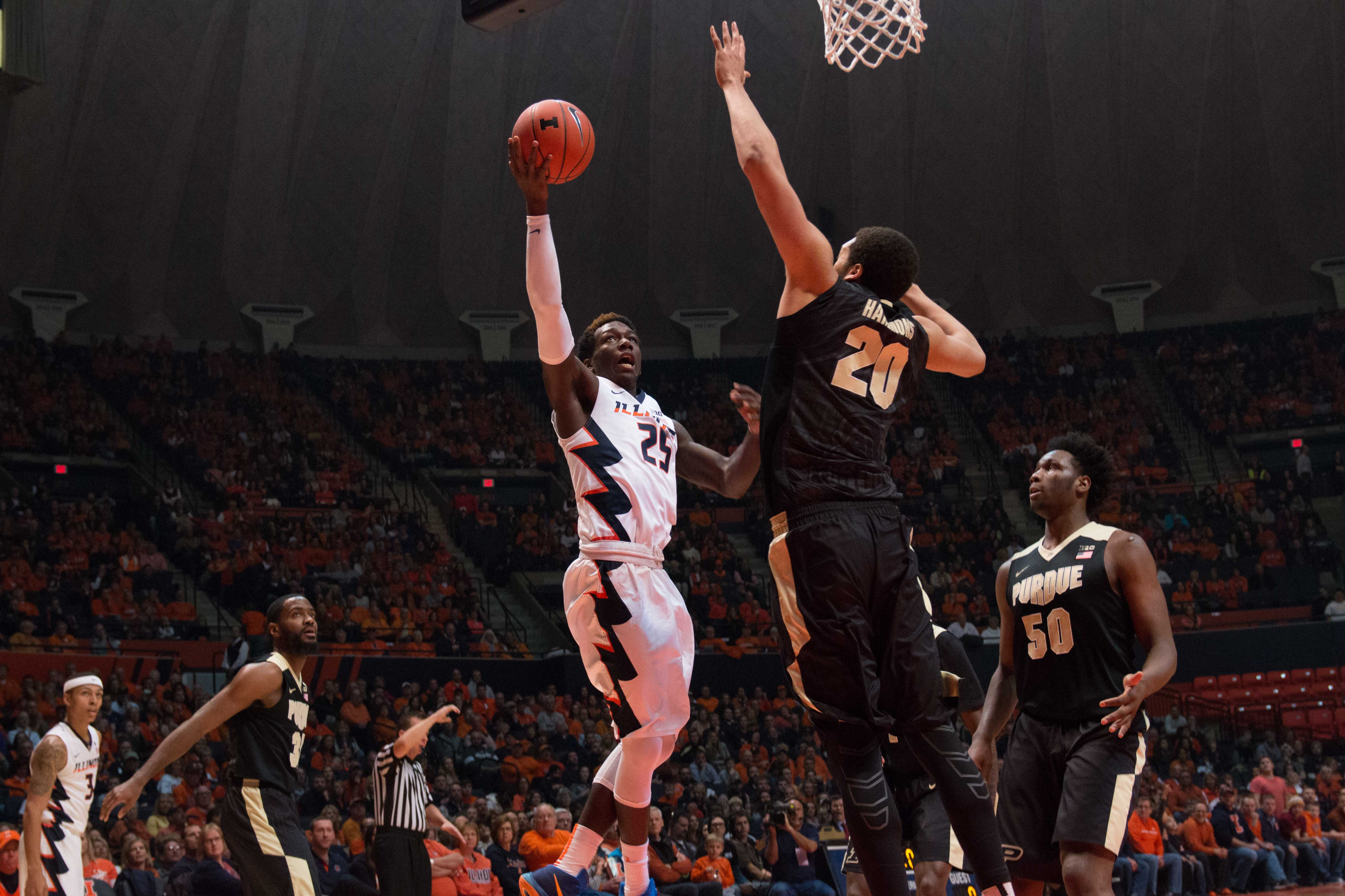 Illinois' Kendrick Nunn puts up a layup over Purdue's A.J. Hammond during the Illini's 84-70 victory over the Boilermakers at State Farm Center on Sunday. Nunn dropped 22 points in his first game back since missing time to attend the birth of his first child.