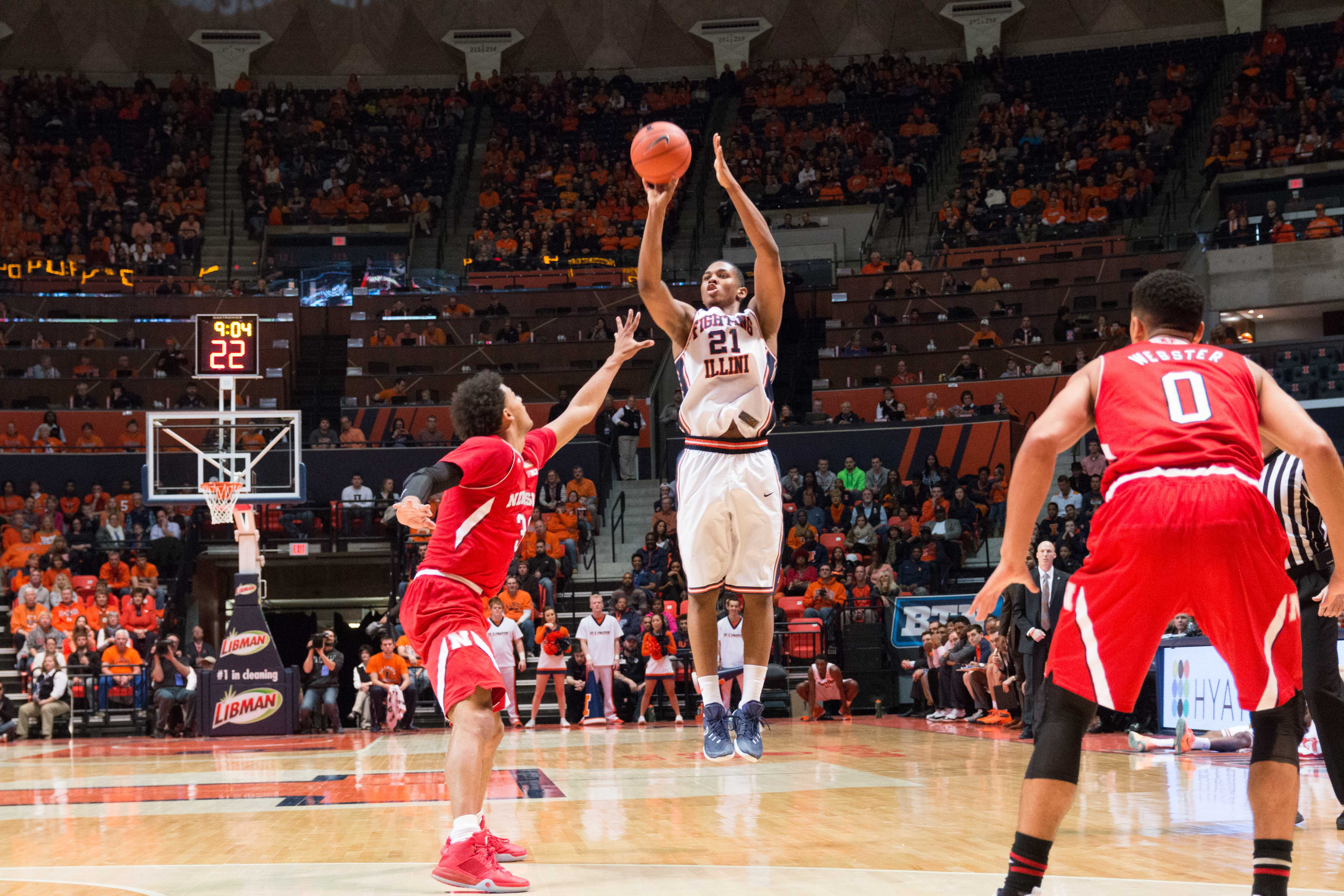 Illinois' Malcolm Hill shoots a 3-pointer over Nebraska's Shavon Shields during the Illini's 78-67 loss to the Huskers at State Farm Center on Saturday.